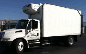 large bobtail ice delivery truck